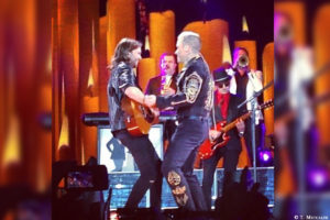 "Tim Metcalfe and Robbie Williams performing ""Angels"""